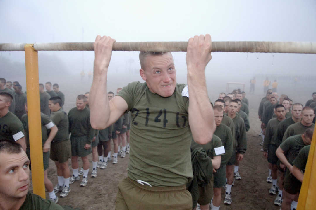 A recruit does pull ups as part of the Marine Corps Physical Fitness Test