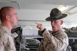 A Marine Drill Instructor gives corrections to a recruit at Marine Corps Recruit Depot San Diego.