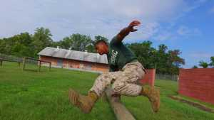 Marine Corps OCS trainer on the obstacle course
