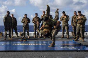 Marines practice martial arts onboard a naval ship